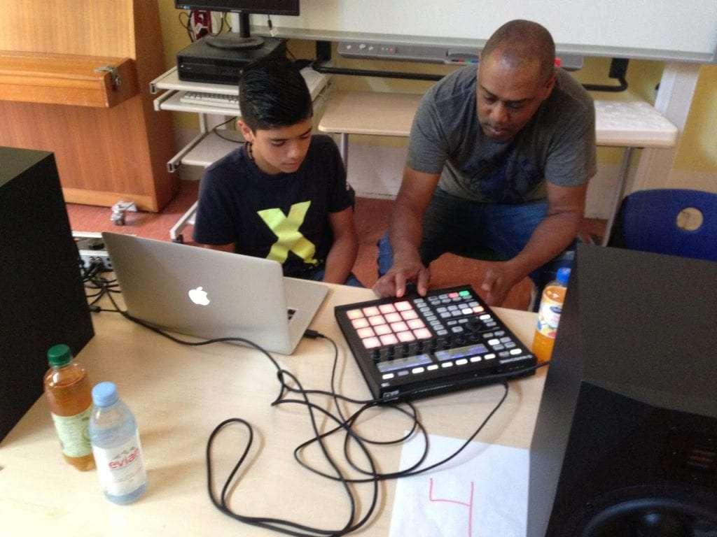 Mike mentoring children